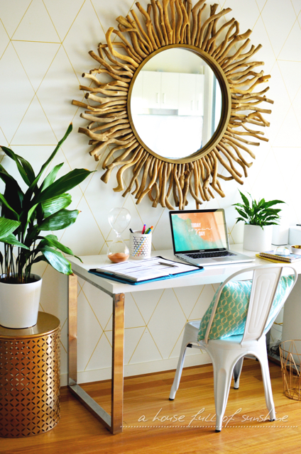 Home office with gold paint pen wall