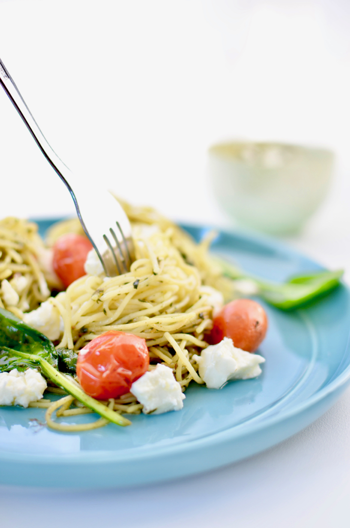 Pesto pasta with blistered cherry tomatoes